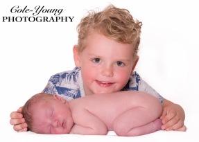 newborn photoshoot with brother